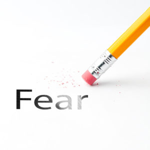 Closeup of pencil eraser and black fear text. Fear. Pencil with eraser.